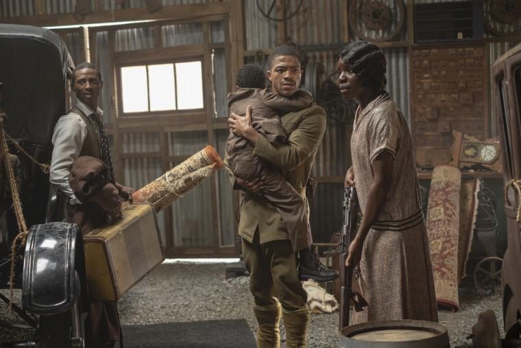 """Dajour Ashwood, Steven Norfleet and Alexis Louder in a scene from \""""Watchmen.\"""""""