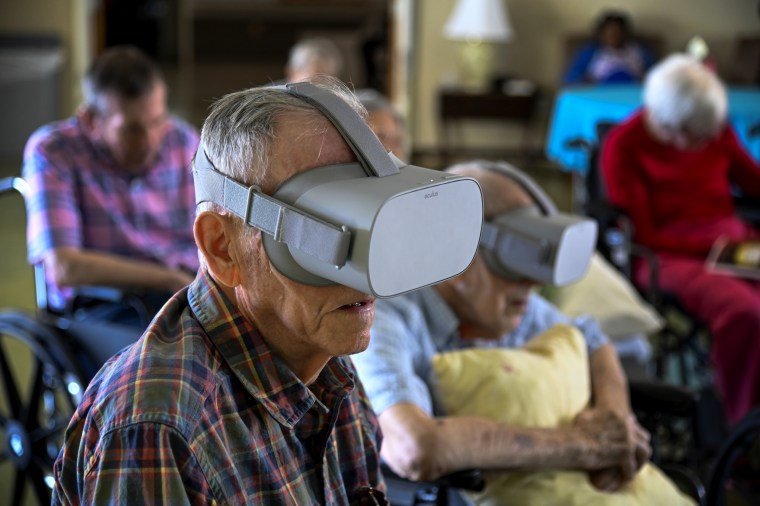 Image: Jim Halsey watches nature scenes through a virtual reality device at the Powhatan Nursing Home in Falls Church, Va., on Oct. 10, 2019.