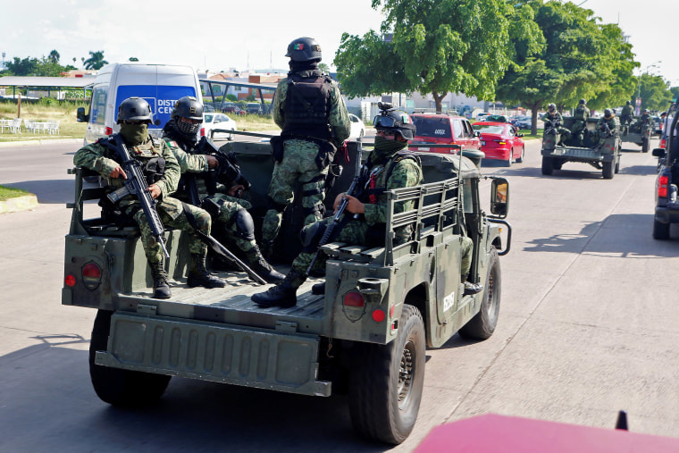 Image: Special unit of Mexican Army conduct patrol after cartel gunmen clashed with federal forces in Culiacan