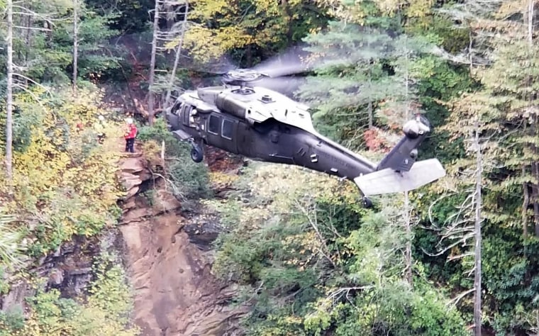Image: A hiker died after plunging down a 75-foot waterfall in North Carolina.