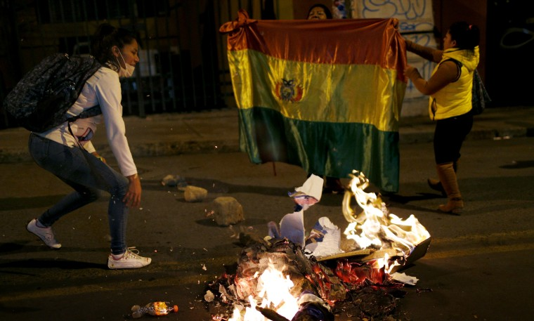 Image: Protesters burn campaign posters of the ruling party outside the Supreme Electoral Court in La Paz, Bolivia, on Oct. 21, 2019.