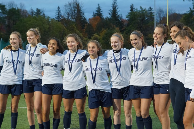 Soccer players on the Burlington High School team in Vermont. The team was penalized last week with a yellow card after revealing their #EqualPay T-shirts during a game.
