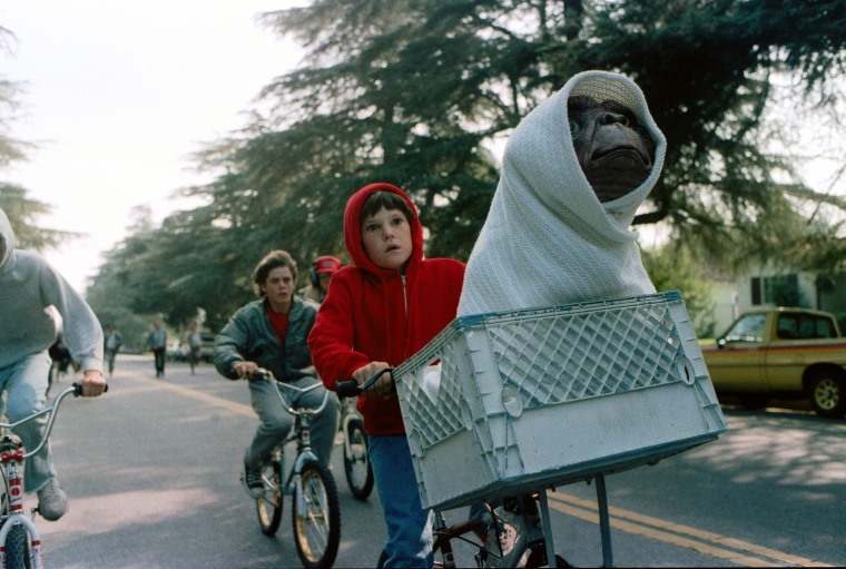 "Henry Thomas as Elliott and E.T. in a basket on a bicycle in a scene from director Steven Spielberg's 1982 movie ""E.T.: The Extra-Terrestrial."