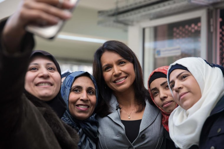 Rep. Tulsi Gabbard takes a photo with women from Barzi, Syria, many of whom have husbands or family members who are soldiers, during her trip to Syria in January 2017.