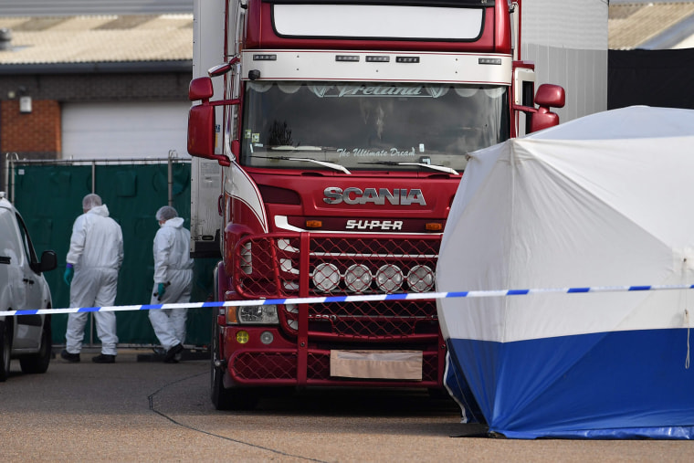 Image: Police officers in a forsensic suits at the scene of a lorry found to be containing 39 dead bodies at Waterglade Industrial Park in Grays, Essex, on Oct. 23, 2019.