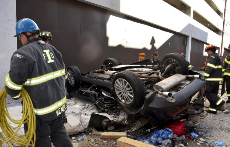 Image: Two people are dead after a car drove off a 4th floor parking garage in Indianapolis on Oct. 23, 2019.