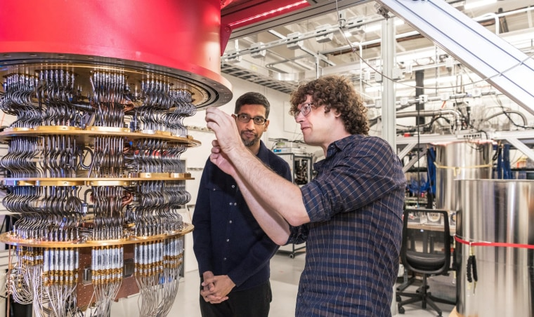 Image: A handout picture shows Pichai and Sank with one of Google's Quantum Computers in the Santa Barbara lab