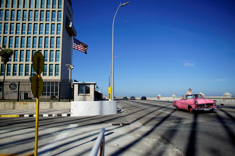 Image: FILE PHOTO: Tourists in a vintage car pass by the U.S. Embassy in Havana