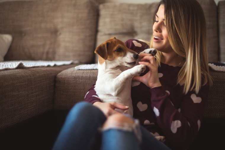 Image: Woman with puppy