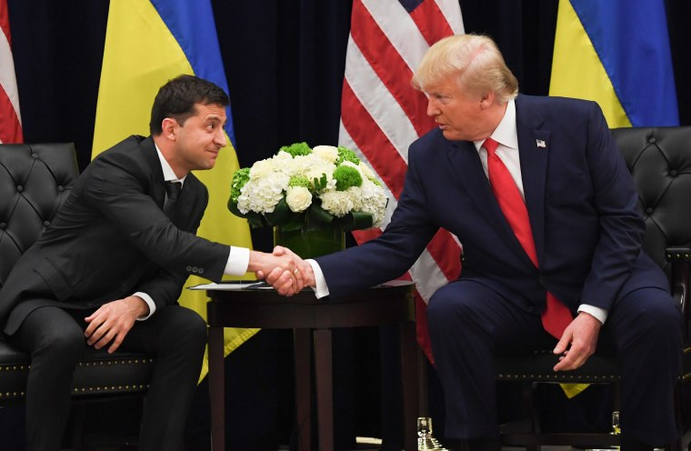 Image: President Donald Trump and Ukrainian President Volodymyr Zelensky shake hands during a meeting in New York o