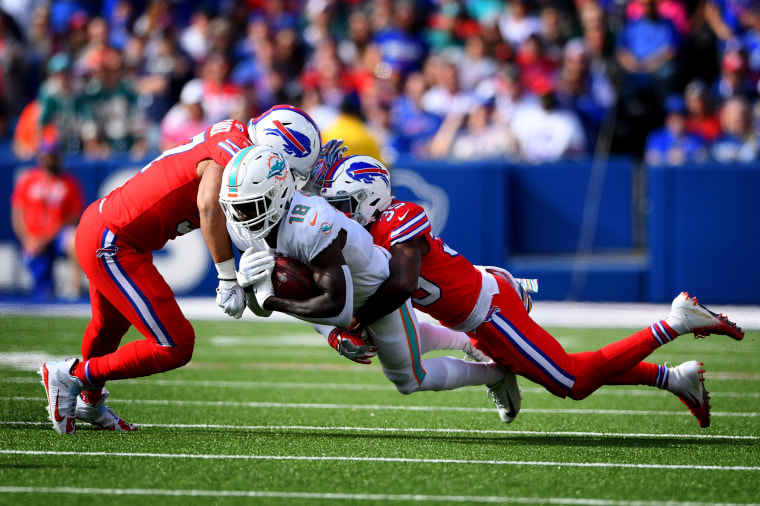 Image:Miami Dolphins wide receiver Preston Williams dives with the balls as Buffalo Bills player tackle during a game in Orchard Park, N.Y., on Oct. 20, 2019.