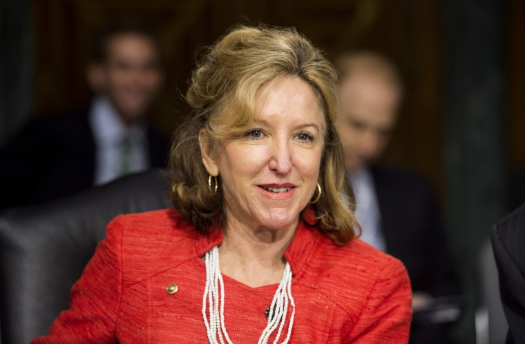 Image: Sen. Kay Hagan, D-NC, takes her seat during a committee hearing in 2014.