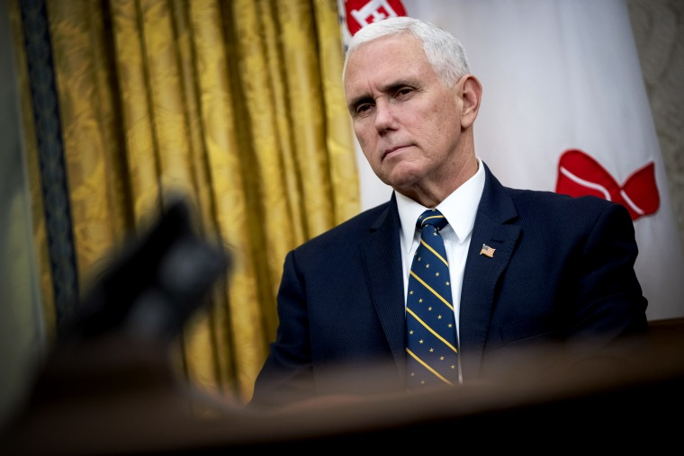 Image: Vice President Mike Pence listens during a meeting in the Oval Office on Jan. 31, 2019.