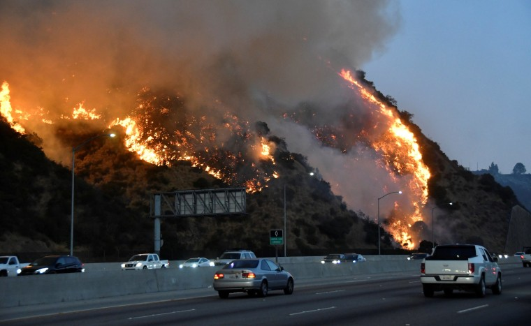 Image: The Getty Fire burns near the Getty Center along the 405 freeway north of Los Angeles, California