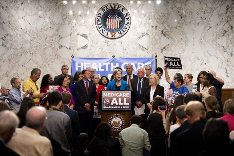 Image: Sen. Elizabeth Warren speaks alongside Sen. Bernie Sanders about Medicare for All legislation on Capitol Hill in 2017.