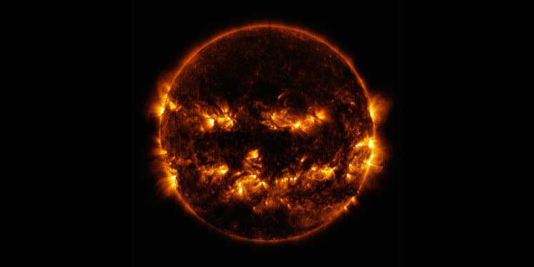 Image: On October 8, 2014, active regions on the sun gave it the appearance of a jack-o'-lantern. This image is a blend of 171 and 193 angstrom light as captured by the Solar Dynamics Observatory.