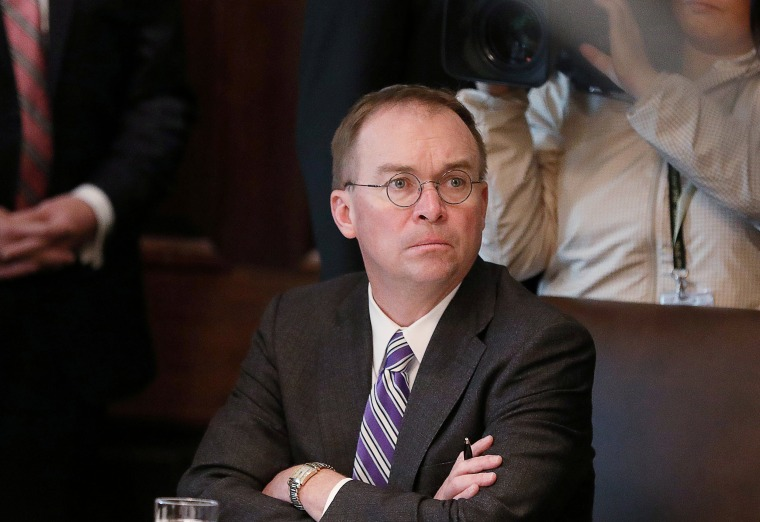 Image: FILE PHOTO: Acting White House Chief of Staff Mulvaney listens during Trump cabinet meeting at the White House in Washington