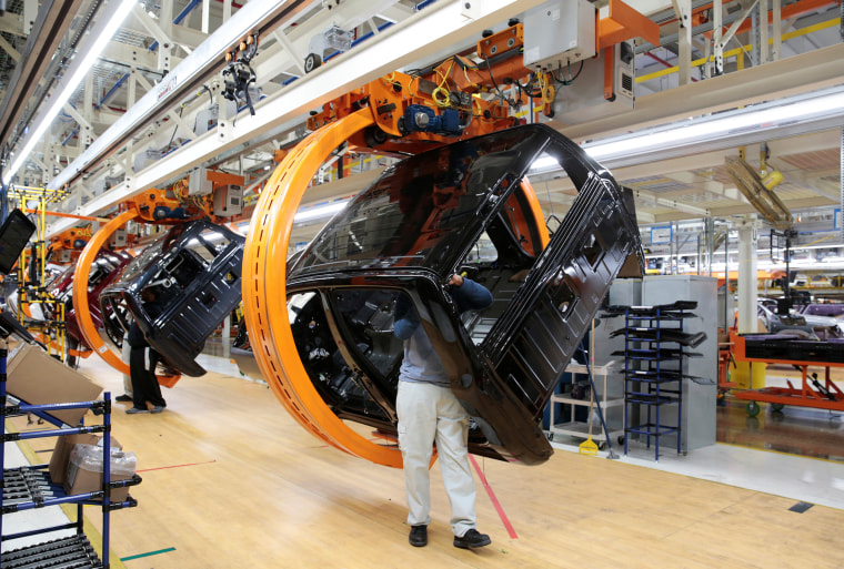 Fiat Chrysler Automobiles assembly workers build 2019 Ram pickup trucks on 'Rotating Carrier' assembly line at the FCA Sterling Heights Assembly Plant in Sterling Heights Michigan