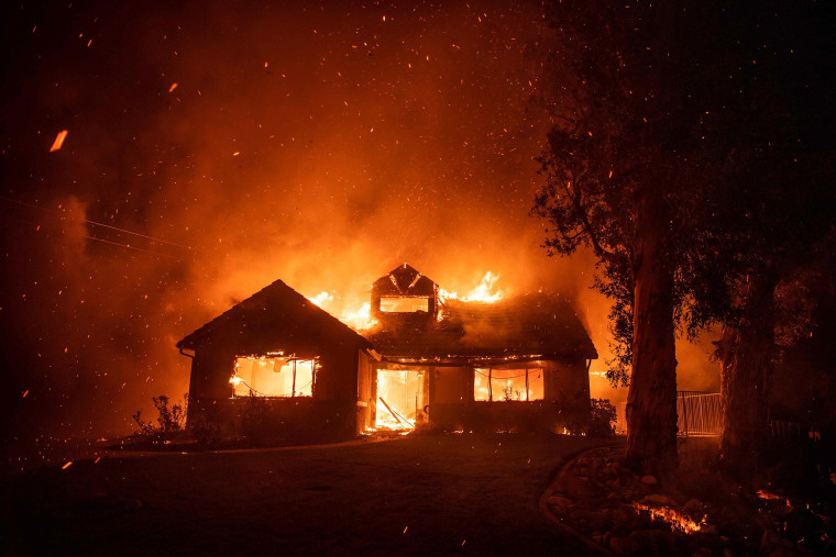 Image: Embers fly through the air as a home burns during the Hillside Fire in the North Park neighborhood of San Bernardino, California