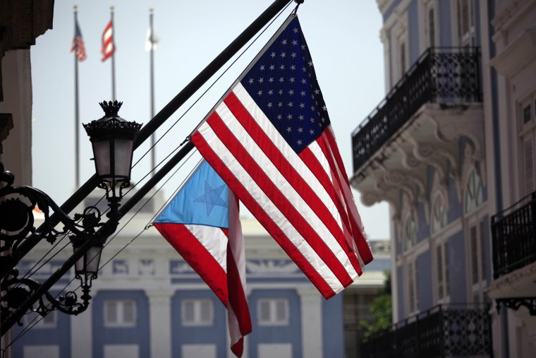 The U.S. and Puerto Rico flags hang outside the governor's mansion in Old San Juan.
