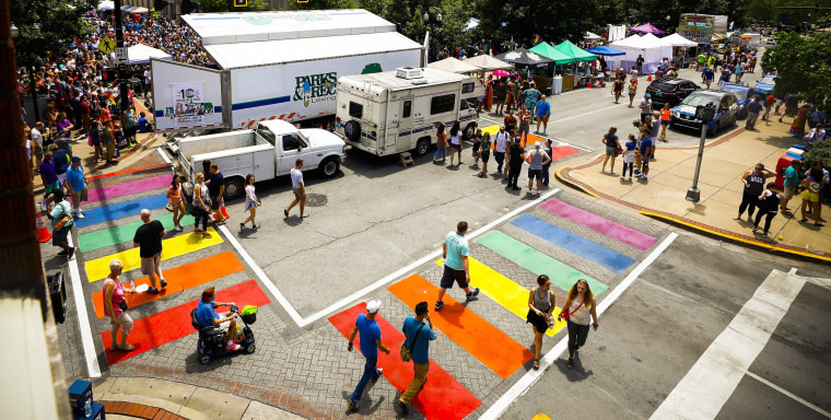 Pedestrians use the rainbow crosswalks at the Lexington Pride Festival in 2017. The state's Supreme Court has sided with a print shop owner who refused to make a shirt promoting the festival.