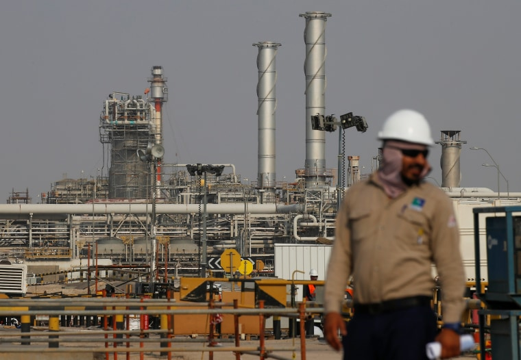 Image: An employee looks on at Saudi Aramco oil facility in Abqaiq