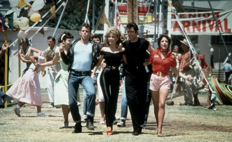 "Image: Jeff Conaway, Olivia Newton-John, John Travolta and Stockard Channing in the movie \""Grease.\"""