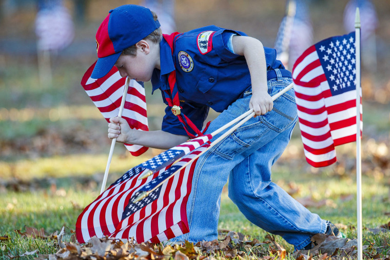 Ted Gaine, 7, of Dorothy from Pack 254, help planted over 5,000 American flags at Atlantic County Veterans Cemetery, at 109 Route 50, Estell Manor on Wednesday. Nov. 6, 2019.