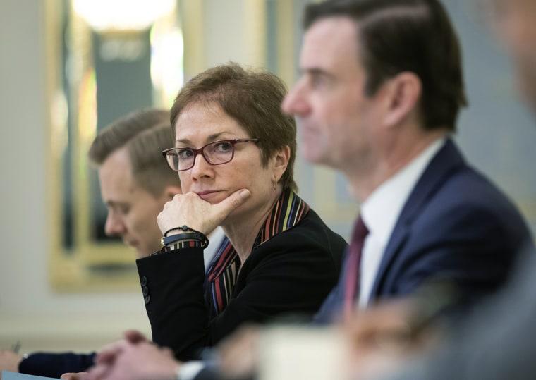 Then U.S. Ambassador to Ukraine Marie Yovanovitch, center, sits during her meeting with Ukrainian President Petro Poroshenko in Kyiv, Ukraine on March 6, 2019.