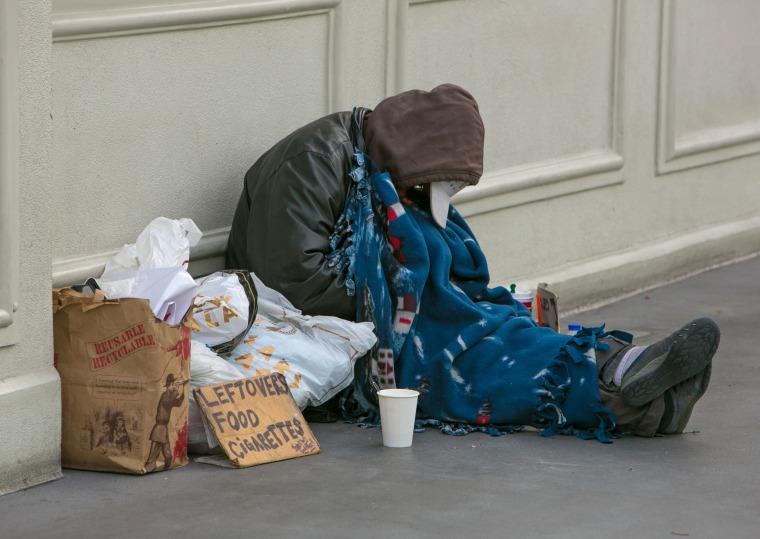 A homeless man sleeps on a pedestrian bridge in Las Vegas in 2015.