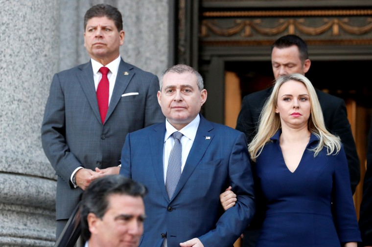 Image: Ukrainian-American businessman Lev Parnas exits following his arraignment at the United States Courthousein New York
