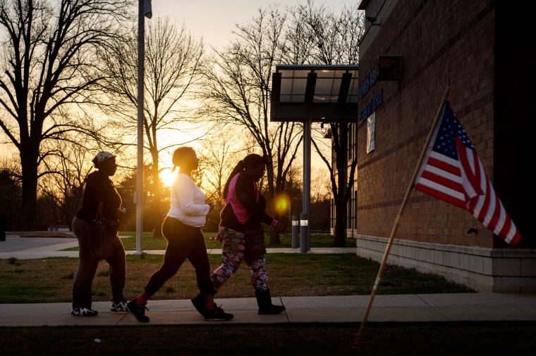 Image: Women arrives to cast their ballots at an elementary school in Ferguson, Mo., on March 15, 2016.