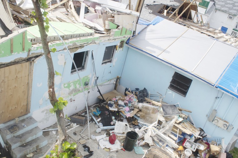 Debris and wrecked homes in Green Turtle Cay, Bahamas, Oct. 18, 2019. Hurricane Dorian tore through the area, bringing 185-mph winds nearly two months ago.