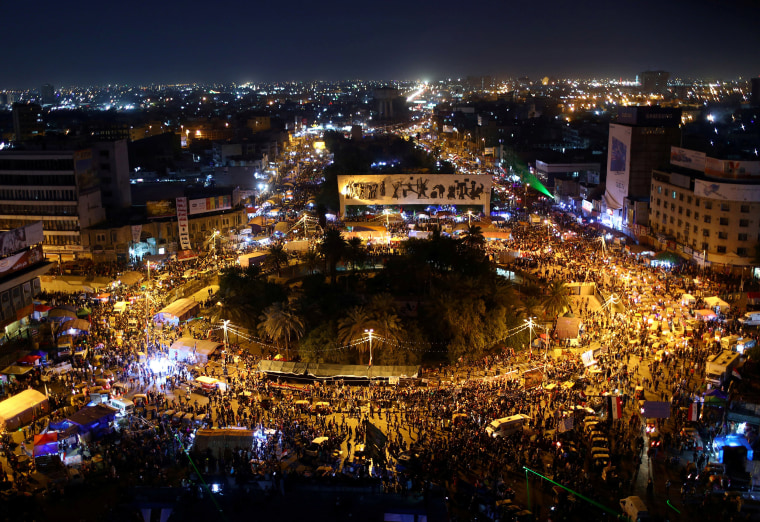 Image: Demonstrators take part during the ongoing anti-government protests in Tahrir square, Baghdad, Iraq