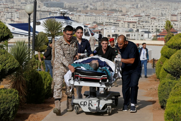 Image: Tourist, who was injured in a stabbing, is brought into King Hussein Medical Center in Amman