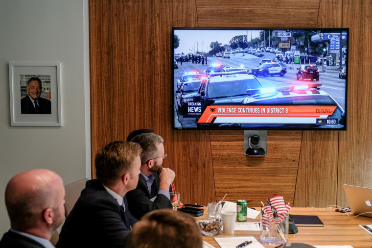"Images of an immersive simulation of mock news events are displayed during an election hacking ""tabletop"" exercise."