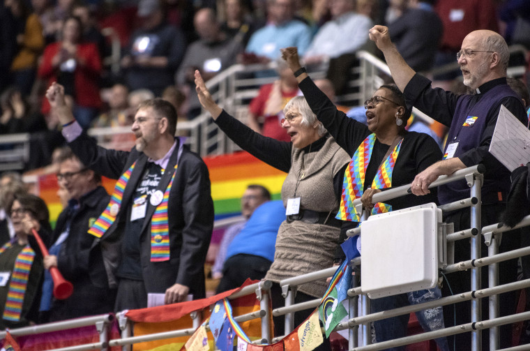 Protesters chant during the United Methodist Church's special session of the general conference in St. Louis on Feb. 26, 2019.