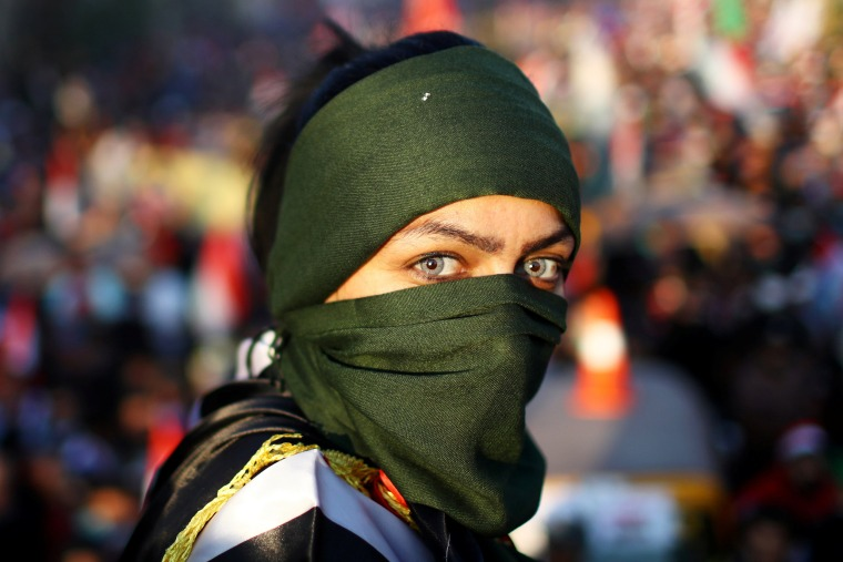 Image: An Iraqi female demonstrator takes part in ongoing anti-government protests in Baghdad