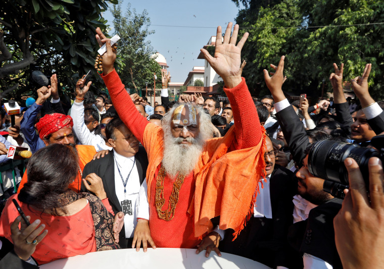 Image: Mahant Dharam Das, chief Priest of Nirmohi Akhara, celebrates after Supreme Court's verdict on a disputed religious site, outside the court in New Delhi