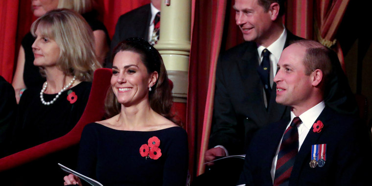 Image: Britain's Prince William and Catherine, Duchess of Cambridge, attend the Festival of Remembrance in London