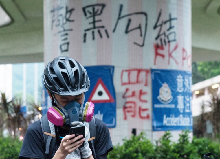 A protester looks at his phone in Hong Kong