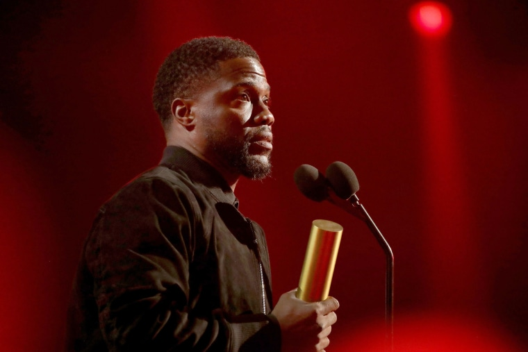 Image: Kevin Hart on stage during the 2019 E! People's Choice Awards held at the Barker Hangar