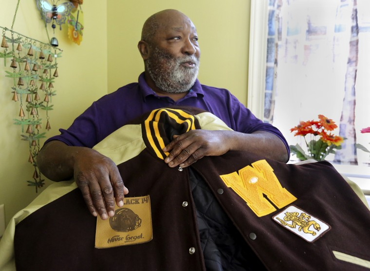 Image: Melvin Hamilton, a member of the Black 14, holds his college letterman jacket in Lake City, S.C., on Oct. 22, 2019.
