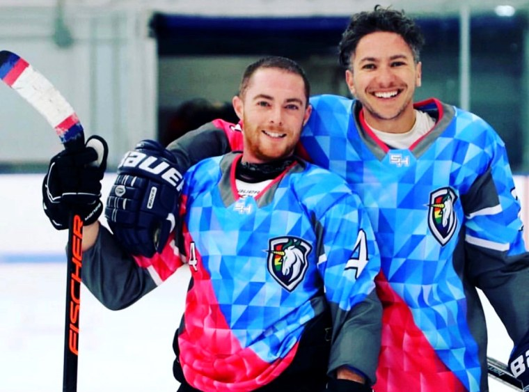 Image: Hutch Hutchinson and Shane Diamond, players on Team Trans for the Boston Pride Hockey League.