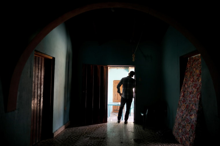 Image: A Honduran father stands at his home in Comayagua on Aug. 23, 2019. He was separated from his 3-year-old daughter at the U.S. border after traveling to seek asylum.