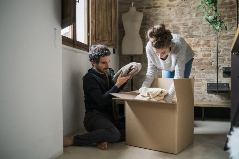 Image: Young couple packing