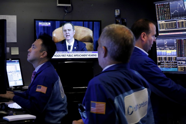 Image: Traders work the floor at the New York Stock Exchange as the impeachment hearing is televised on Nov. 13, 2019.