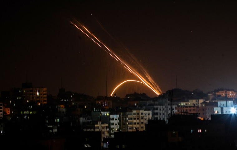 Image: Rockets are fired from the Gaza Strip toward Israel