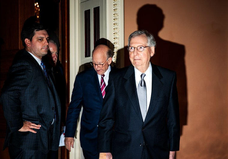 Image: Senate Majority Leader Mitch McConnell leaves a Republican policy lunch at the Capitol on June 26, 2018.