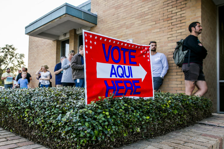 Image: Voters wait outside the Gardner Betts Annex to cast ballots in Austin, Texas, on March 6, 2018.